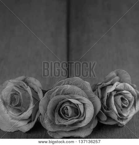 black and white roses On the old wooden table condolence Background