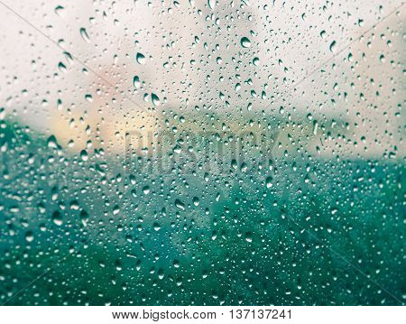 Selective focus and color filter image, Raindrops on glass (raindrops,blur, rain)