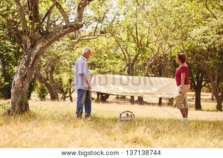 Senior couple old man and woman in park on weekend activity. Grandpa and grandma doing picnic in wood