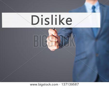 Dislike - Businessman Hand Holding Sign