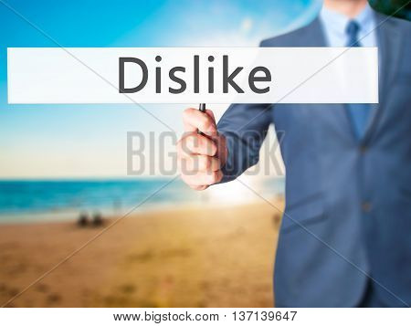 Dislike - Businessman Hand Holding Sign