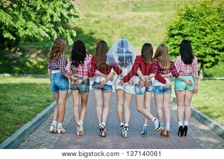 Back View Of Seven Happy And Sexy Girls On Short Shorts Holding Hands On The Buttocks And Posed On R