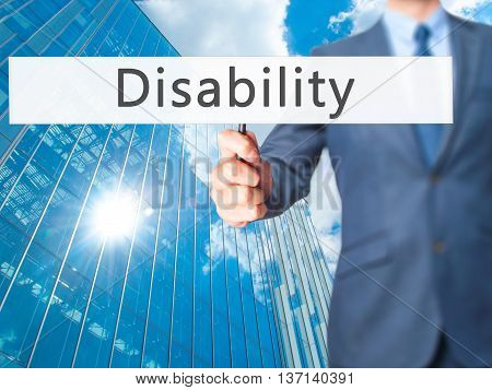 Disability - Businessman Hand Holding Sign