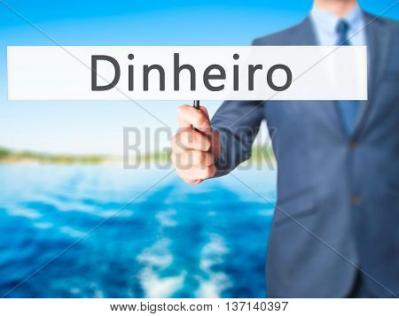 Dinheiro (money In Portuguese) - Businessman Hand Holding Sign