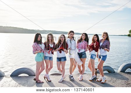 Seven Girls On Short Shorts Posed At Sunset Lake On Bachelorette Party