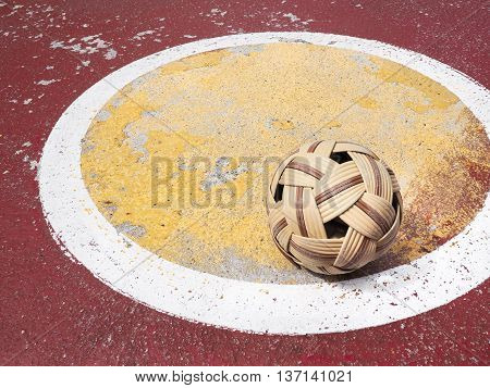 Old Sepak Takraw ball on street sepak takraw court, With place your text