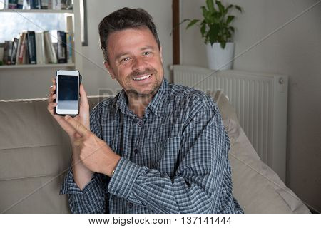 Handsome Middle Aged Man Is Using A Smartphone,