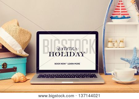 Laptop computer mock up template with beach items and home decor objects. Planning summer holiday vacation concept.