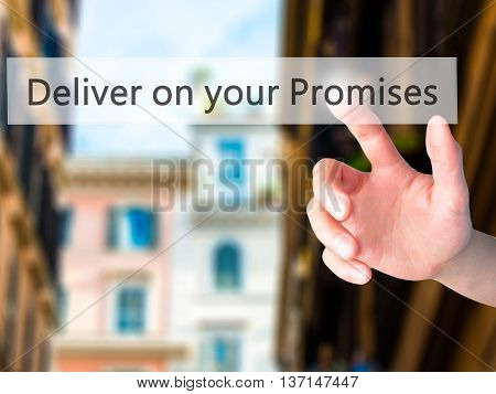 Deliver On Your Promises - Hand Pressing A Button On Blurred Background Concept On Visual Screen.