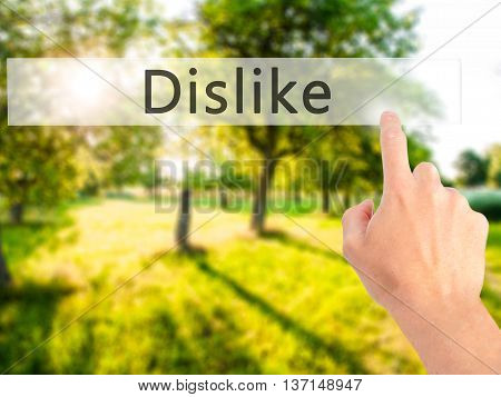 Dislike - Hand Pressing A Button On Blurred Background Concept On Visual Screen.