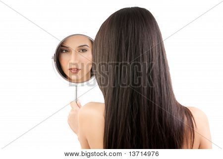 A Beauty Image Of A Young Woman Looking Into A Mirror.