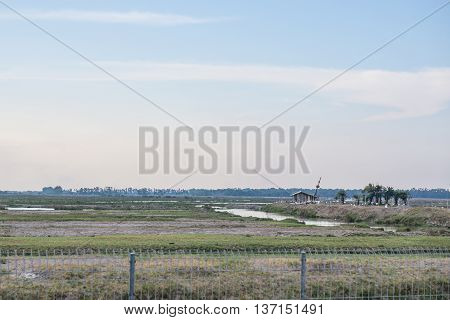 Wooden small house in a countryside farmland with blue sky in Phatthalung Thailand.