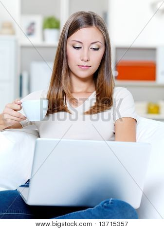 Serious Woman With Laptop And Cup Of Coffee