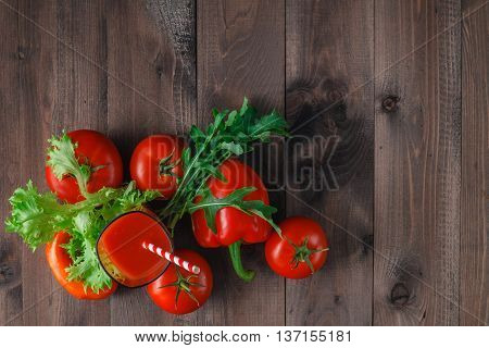 Glass Of Tasty Tomato Juice And Fresh Tomatoes On Table