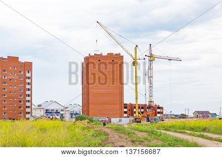 Berdsk Novosibirsk oblast Siberia Russia - June 26 2016: construction of multi-storey houses of brick at the edge of town