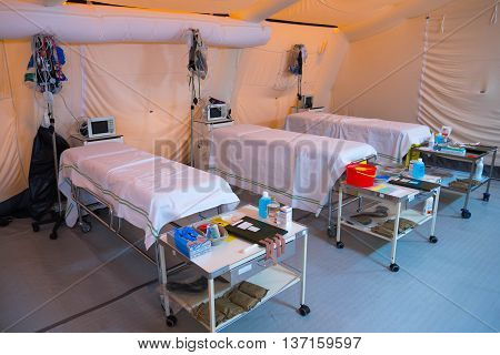 A field hospital is a small mobile medical unit, or mini hospital, that temporarily takes care of casualties on-site before they can be safely transported to more permanent hospital facilities.