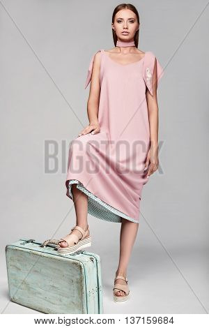 Portrait Of Fashion Stylish Woman With Case In Colorful Skirt