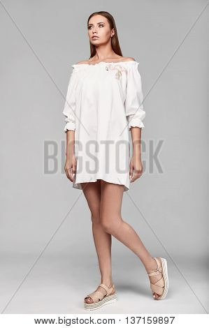 Portrait Of Fashion Glamor Stylish Woman In White Skirt