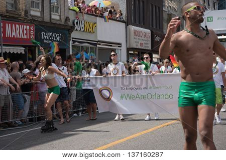Toronto Canada - July 3 2016: We are Orlando - banner. The 36th annual Pride Parade celebrates all kinds of diversity and life in Toronto while encouraging tolerance and acceptance.