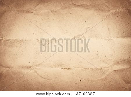 Old crumpled, recycled brown paper texture or background.