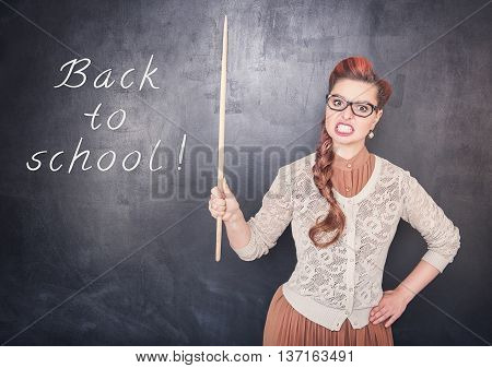 Angry Teacher With Pointer On Blackboard Background