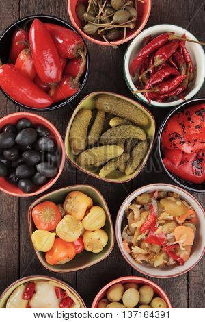 Pickled cucumber, peppers, olives chili and caper fruit