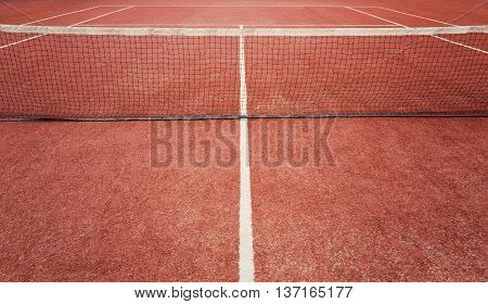 Outdoor red painted grass tennis court background