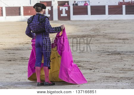 Linares SPAIN - August 28 2014: The Spanish Bullfighter bullfighting with the crutch in the Bullring of Linares Spain