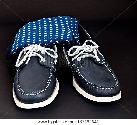 Blue Docksides deck shoes with hand-linked toes socks isolated on black