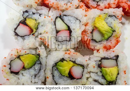 Top view of California roll sushi with red fish roe