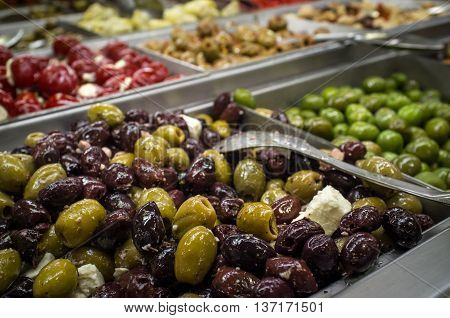 Close up of fresh Italian olive bar self serve