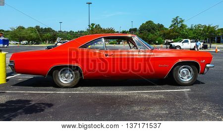 GLOUCESTER VA - MAY 28 2016: A red 1965 Chevrolet Impala SS 396 at the First Aaron's rental car and Motorcycle show the show is Sponsored by Aaron's furniture rental of Gloucester