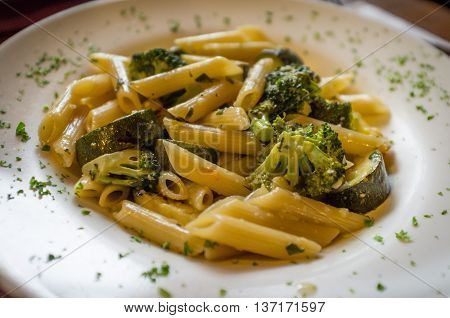 Vegetarian penne primavera with white wine sauce and green vegetables