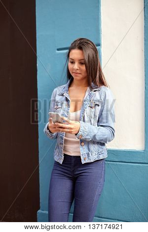 Pretty Young Girl Looking At Cellphone