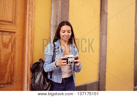 Pretty Young Girl Looking At Her Camera Smiling