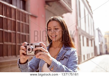 Pretty Girl Looking At The Picture On Her Camera