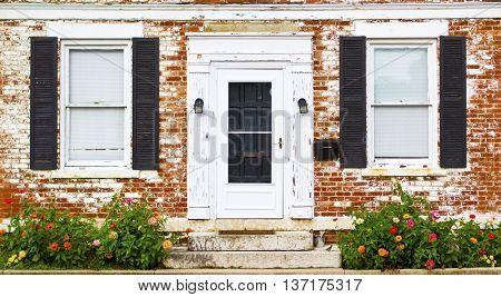 Antique Front Door Windows Shutters and Flower Bed in Columbus Ohio German Village