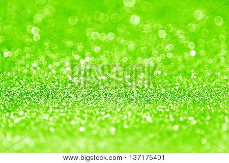 Neon green glitter sparkle background or confetti party invite