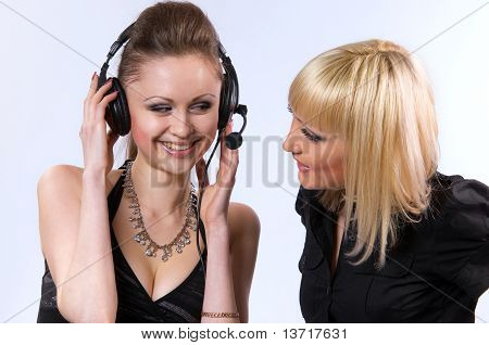 Two Women Listening To Music