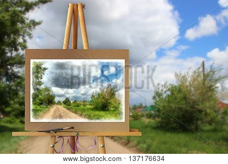 Easel with a painting on a canvas on a landscape. Distant horizon attracts attention and the road calls for adventure. Photo manipulation concept.
