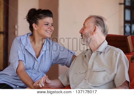 carer with happy senior man
