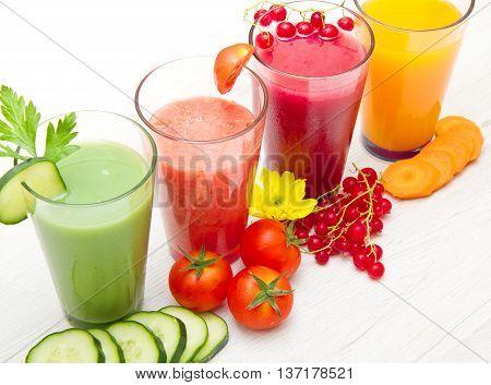 some various Freshly Vegetable Juices on wood