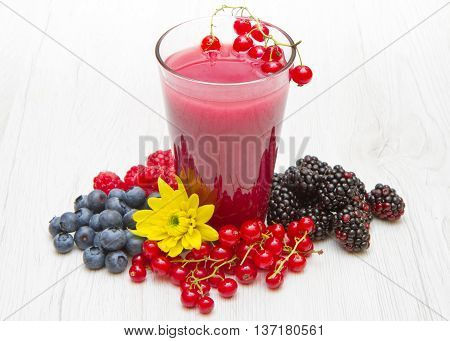 Glass of delicious blackberry , raspberry and blueberry juice