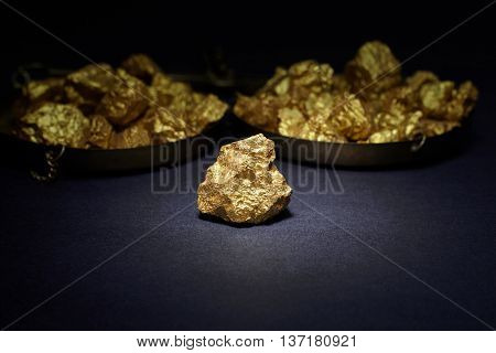 Closeup of big gold nugget in black background
