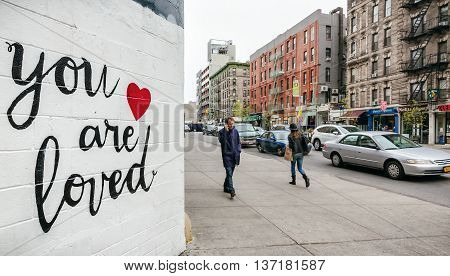 NEW YORK USA - Apr 28 2016: You are loved. Little Italy street scene. The Americans on the streets of Manhattan in NYC.