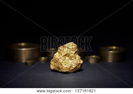 Closeup of big gold nugget and weights copper