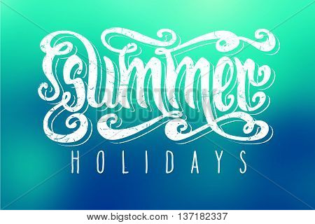 Hand drawn textured words 'Summer Holidays' over abstract smooth blur blue background.