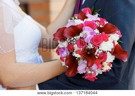 beautiful bridal bouquet of roses orchids and callas