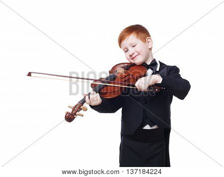 Cute redhead child plays violin isolated at white background. Red-haired charming boy musician in tailcoat or tuxedo smile. Classical music study concept