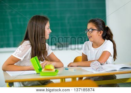 Portrait of two girls in the lunch break at the school selective focus
